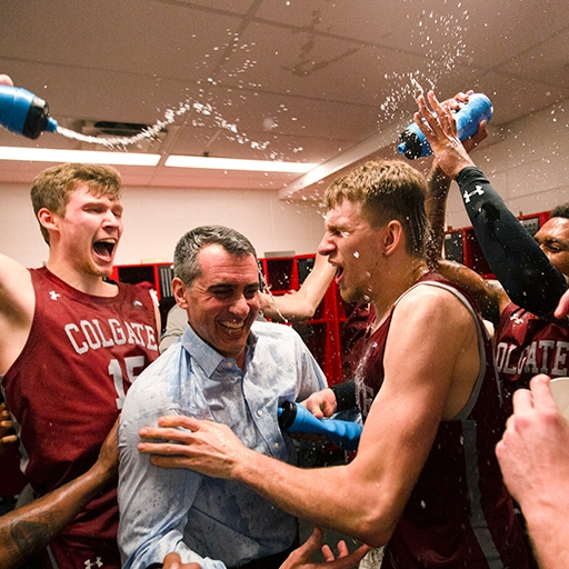 Colgate University's Men's basketball team celebrates in the locker room after upsetting University of Cincinnati