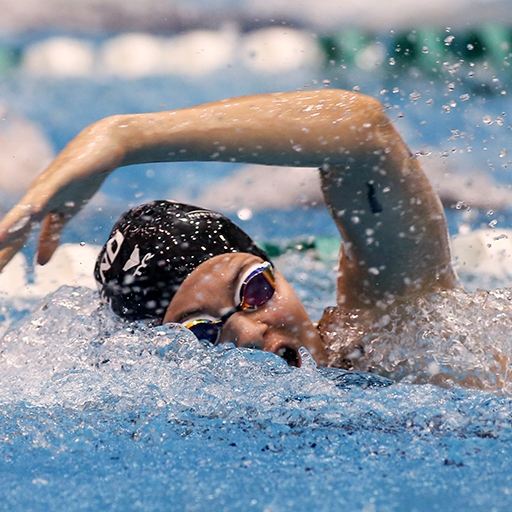 A Cleveland state University swimmer competes in the Magnus Cup in the Busbey Natatorium in Cleveland, Ohio
