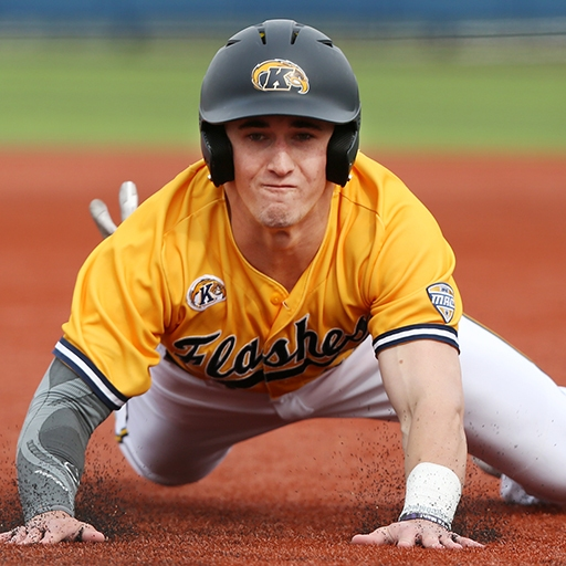 A Kent State University baseball player dives to third base during an NCAA game at in at Schoonover Stadium Kent, Ohio