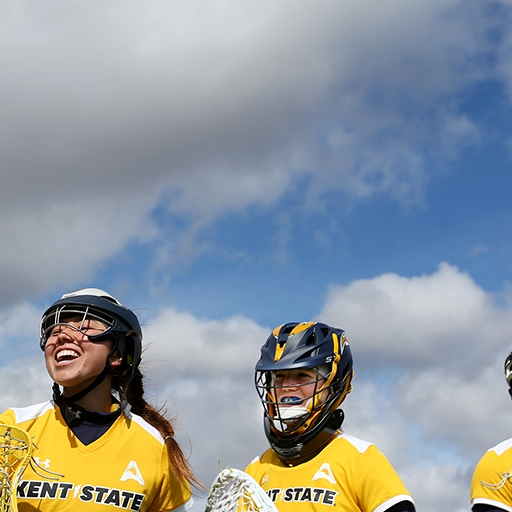 Kent State's Women's lacrosse team smiles during team introductions on a sunny day at Dix Stadium in Kent, Ohio