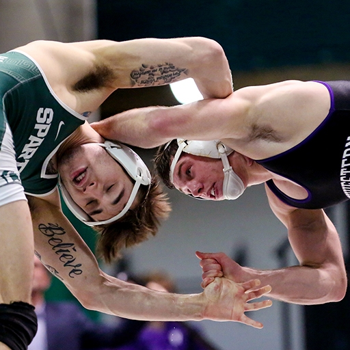 Northwestern University's Ryan Deakin wrestles with a Michigan State athlete in Jenison Field House in East Lansing, Michigan