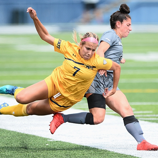 Kent State University's Yasmin Hall battles with a St. Bonaventure athlete during a soccer match in Dix Stadium in Kent, Ohio